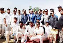 Winners of T20 cricket tournament posing along with Advisor Farooq Khan at Samba on Sunday.