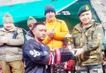 Winner being presented a trophy by the Army Officer in Kargil. -Excelsior/Basharat Ladakhi