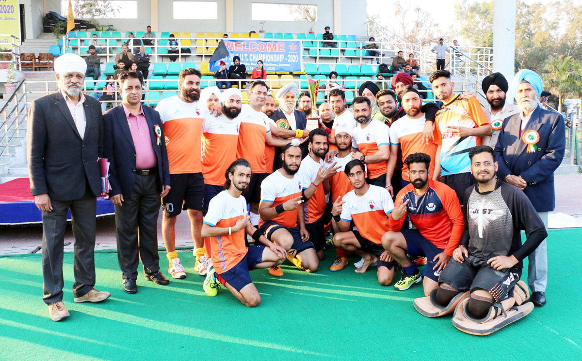 Winners of Hockey Championship posing along with dignitaries and officials in Jammu.