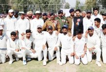Cricketers posing along with DGP Dilbag Singh and other dignitaries during inaugural ceremony of Police Martyrs Tournament.