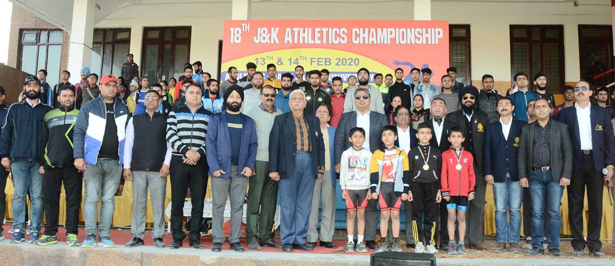 Winners of J&K Athletics Championship posing along with chief guest at JU grounds, Jammu on Friday.