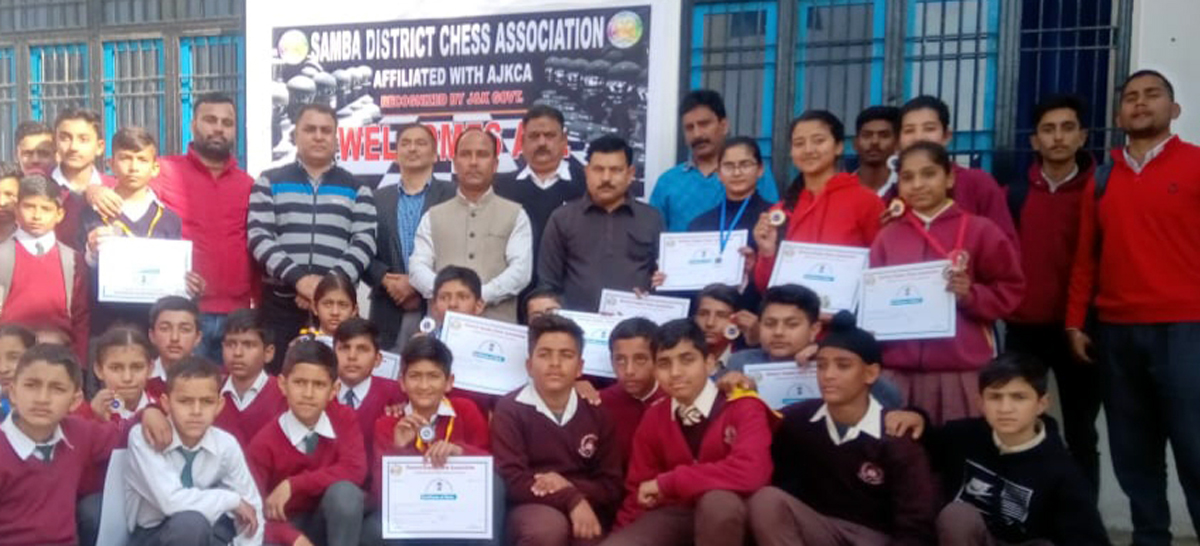 Winners of Samba District Chess Championship posing along with dignitaries and officials at Samba on Friday.