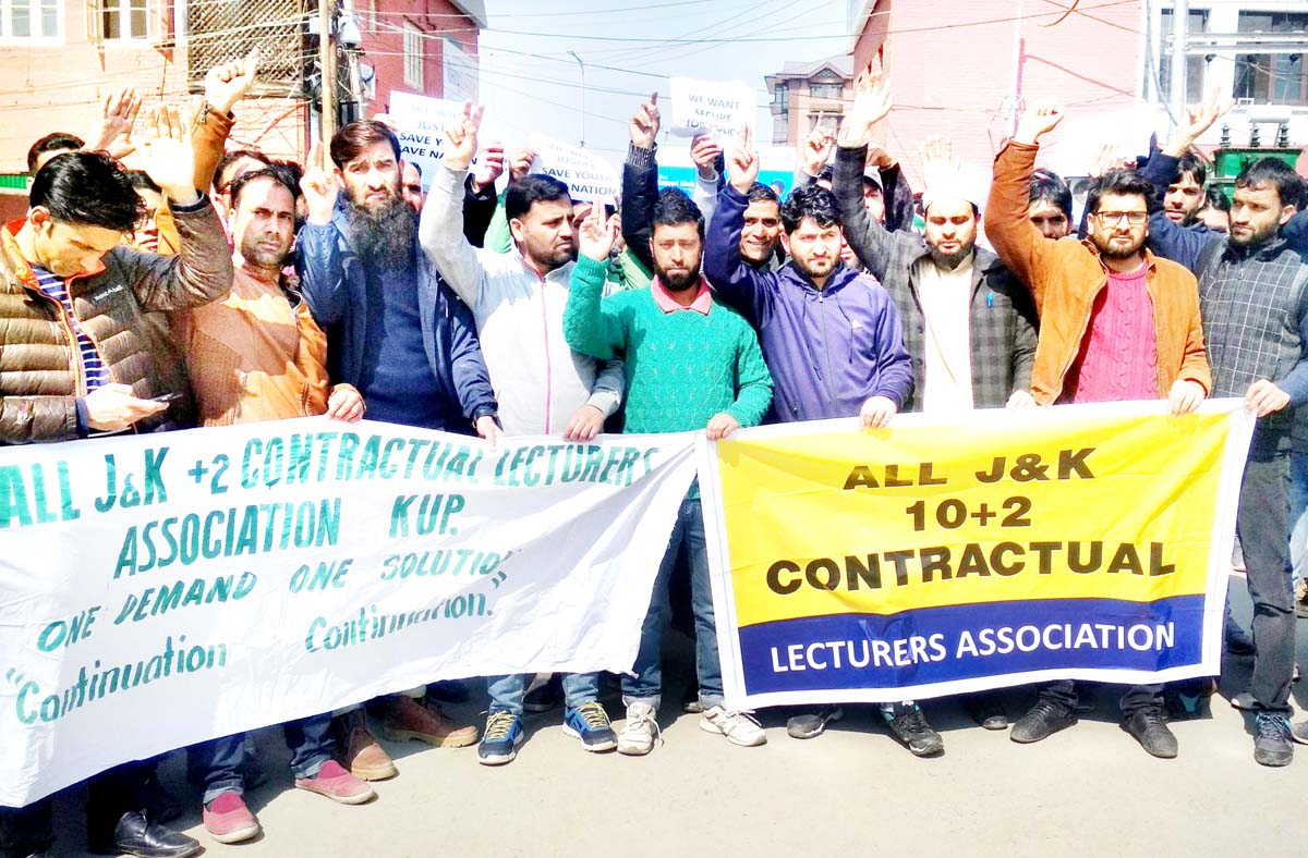 10+2 contractual lecturers during a protest in Srinagar on Monday. -Excelsior/Shakeel