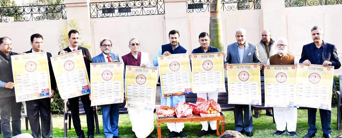 RSS J&K Chief P.Dadhichi, former Minister Sham Lal & others releasing 'Kailakh Sandesh Panchang' during a function at Thathar in Jammu.