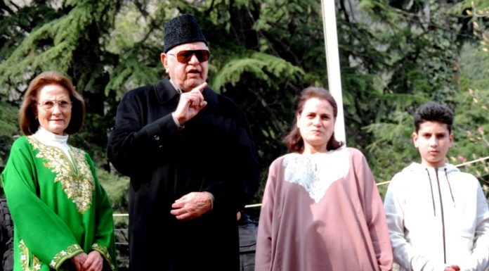 National Conference president Dr Farooq Abdullah (MP) whose PSA was revoked by the authorities flanked by his wife Molly, daughter Safia Abdullah and grandson in the lawns of his Gupkar house in Srinagar on Friday. (UNI)