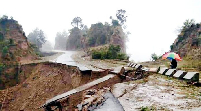 Jammu-Rajouri-Poonch highway damaged near Kalimata Temple, in Kalidhar area due to rain on Friday evening.