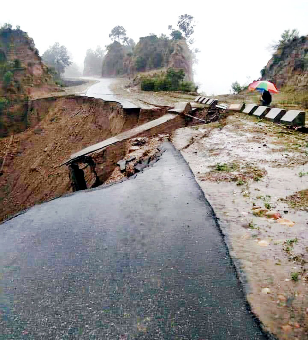 Jammu-Rajouri-Poonch highway damaged near Kalimata Temple, in Kalidhar area due to rain on Friday evening.