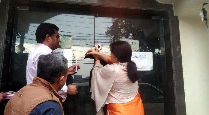 Deputy Commissioner Reasi Indu Chib sealing a hotel in Katra on Friday.