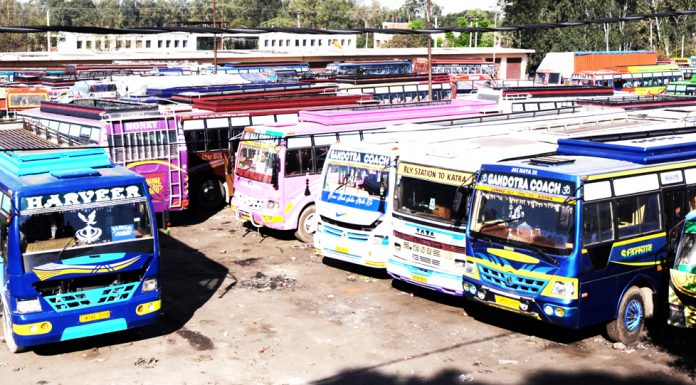 Buses stationed at Narwal Bus stand in Jammu after suspension of public transport. -Excelsior/Rakesh