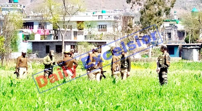 Security personnel at the site where mortar shell landed in Poonch town on Thursday. -Excelsior/Gurjeetbhajan