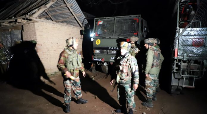Troops near encounter site at Chadoora village of Budgam district on Wednesday.
