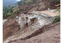 Restoration work in progress at Dalwas near Chanderkote in Ramban on Monday. —Excelsior/Parvaiz Mir