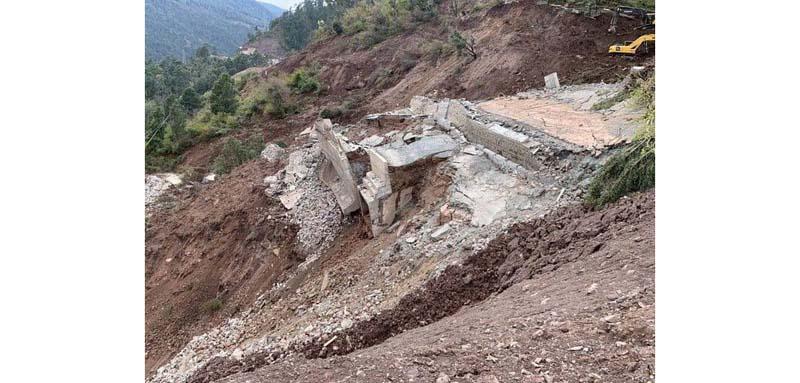 Restoration work in progress at Dalwas near Chanderkote in Ramban on Monday. —Excelsior/Parvaiz Mir
