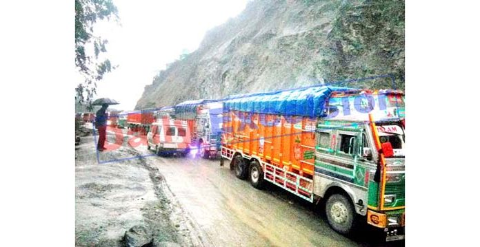 Vehicles stranded on National Highway near Ramban after landslides on Thursday. -Excelsior/Parvaiz Mir