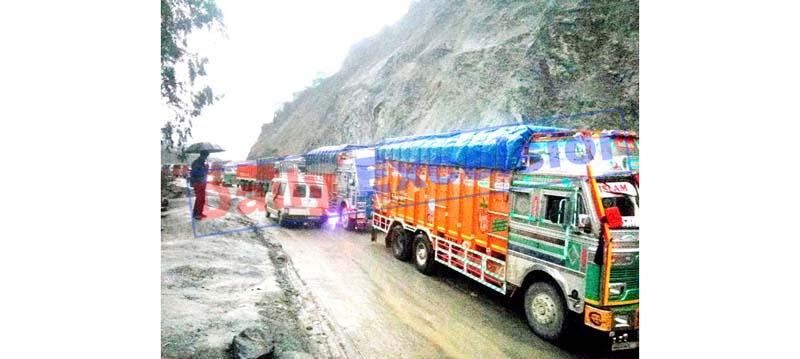 Vehicles stranded on National Highway near Ramban after landslides on Thursday. -Excelsior/Parvaiz Mir