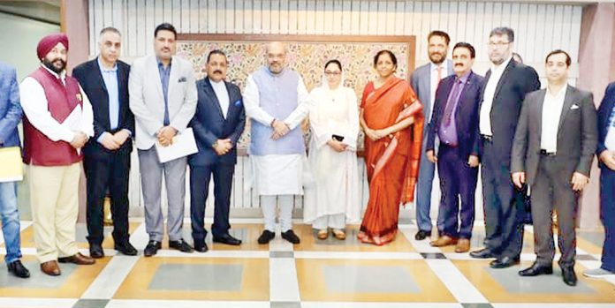 Kashmir traders meeting Union Home Minister Amit Shah in New Delhi on Tuesday.