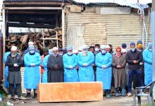 Few people attend burial of first victim of COVID-19 in Sopore on Thursday.