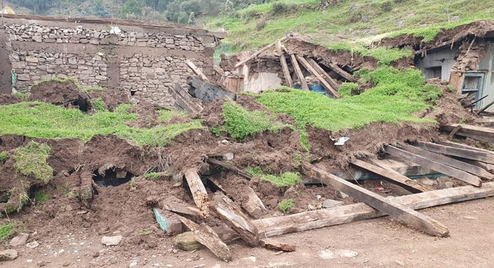 A house collapsed at Chhajla, Mendhar in Poonch on Saturday. -Excelsior/ Rahi Kapoor
