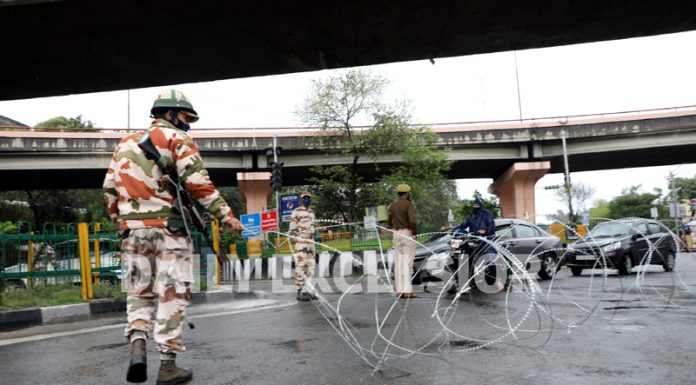 Para-military personnel stop movement of vehicles with concertina wires in Jammu city on Tuesday. -Excelsior/Rakesh