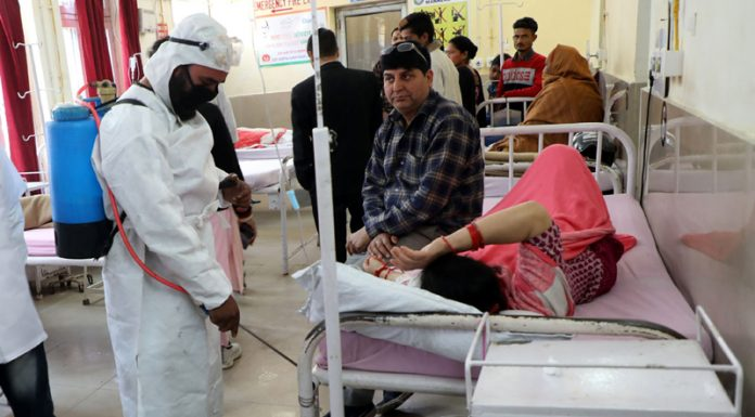 A health worker engaging in sanitizing work in a ward at Government Hospital, Gandhi Nagar in Jammu district.