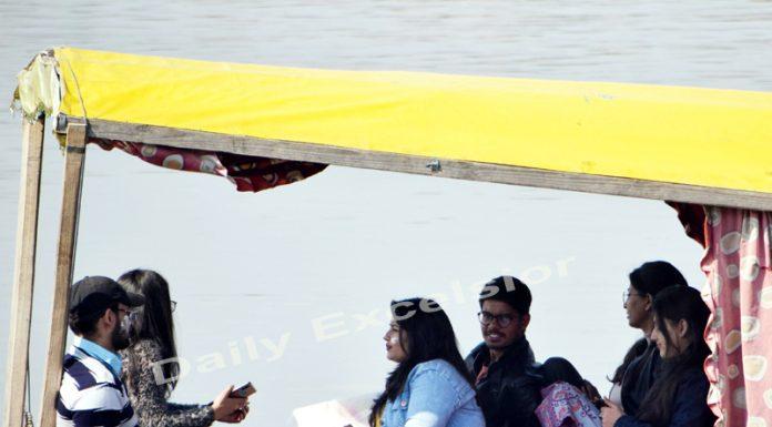 Tourists enjoying Shikara ride at Dal lake during a sunny day in Srinagar. —Excelsior/Shakeel