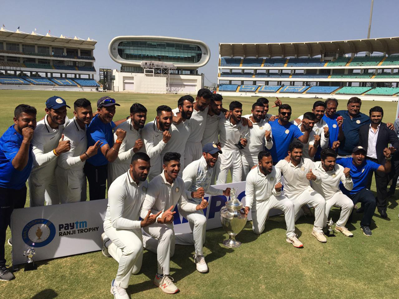 Saurashtra Ranji Trophy Team posing for a group photograph after claiming title.
