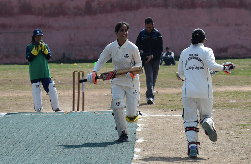 Batswomen running between the wickets during final match of Inter College Women Cricket Rolling Trophy at SP College Ground Srinagar on Monday. —Excelsior/Shakeel