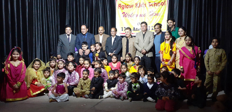 Dignitaries of the function posing for a group photograph along with students during the Annual Day.