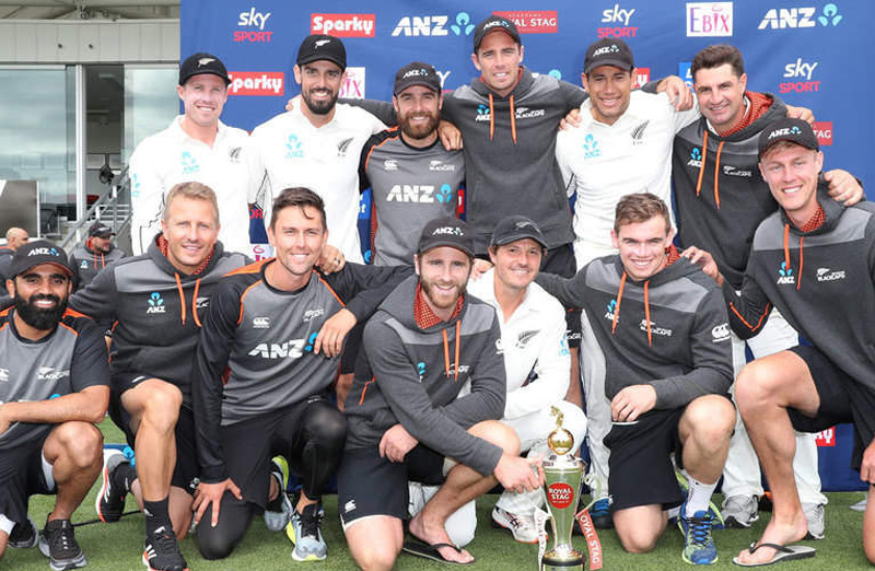 New Zealand team posing for a group photograph after clinching a test series by thrashing India in 2nd Test match at Christchurch.