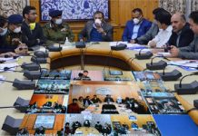 Advisor Baseer Ahmad Khan chairing a meeting at Srinagar on Sunday.