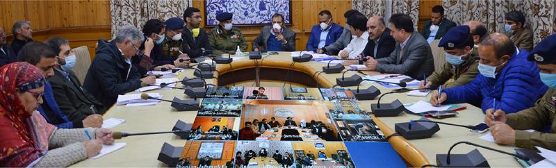 Advisor Baseer Ahmad Khan chairing a meeting at Srinagar on Sunday.
