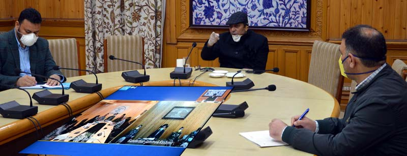 Advisor Baseer Khan chairing a meeting on Wednesday.