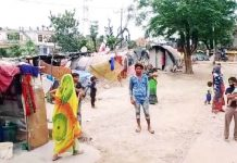 Slum dwellers of Kartholi Bari Brahmana waiting for help. -Excelsior/ Badyal