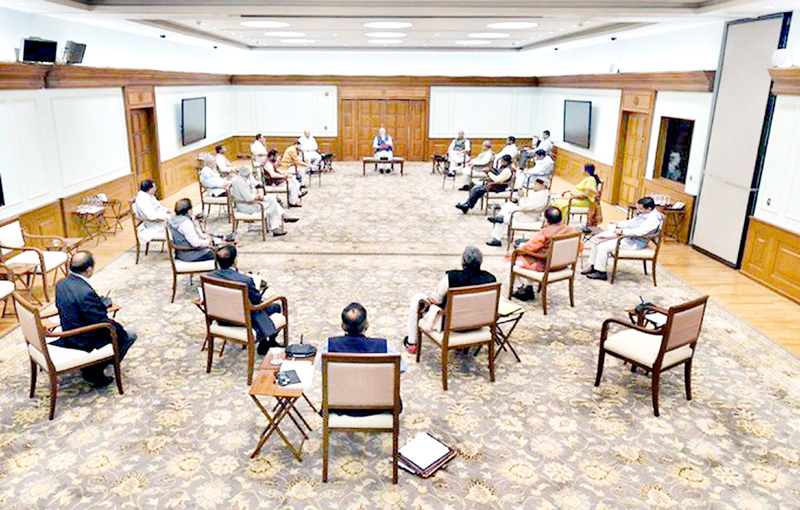 Prime Minister Narendra Modi chairing the meeting of Union Cabinet, while observing social - distancing precautions, at his official residence, 7 Lok Kalyan Marg, New Delhi on Wednesday.