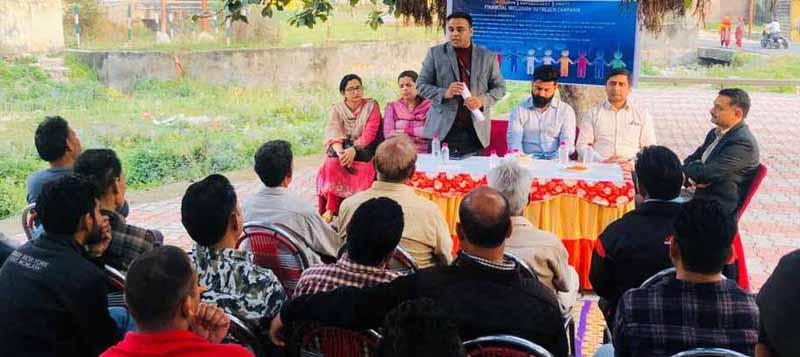 JK Bank officials during a public outreach programme in a Jammu village on Thursday.