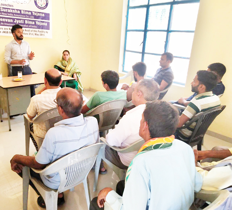 Grameen Bank official addressing an outreach camp at Kotli Jhajjar in R S Pura on Tuesday.