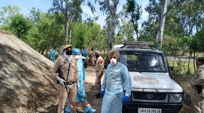 Police parties help Health Department team to pick up a person for quarantine and sample testing in Satwari on Sunday.