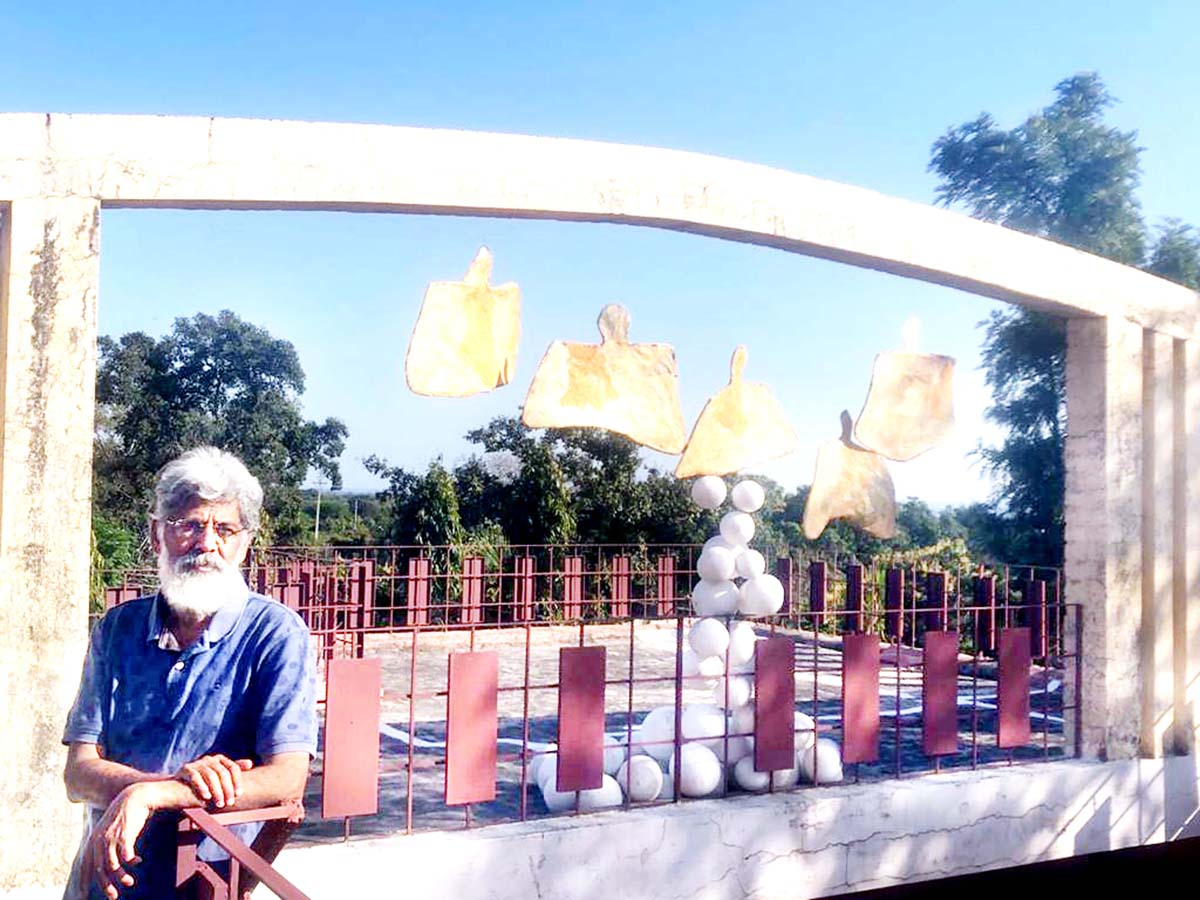 International sculptor from Birpur Ravinder Jamwal posing with his latest creation depicting how Coronavirus is taking world into its grip.