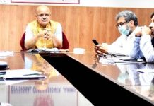 Chief Secretary chairing a meeting at Jammu on Sunday.