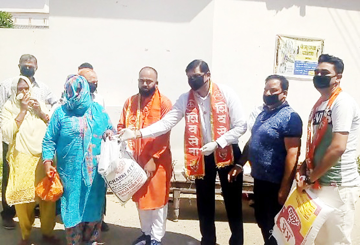 Members of Shiv Sena Balasaheb Thackeray J&K Unit distributing ration among needy people in Bari Brahmana area.