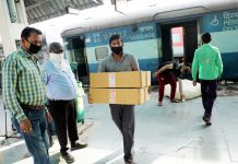 Boxes of masks being unloaded from special parcel van at Jammu Railway Station on Friday. -Excelsior/Rakesh