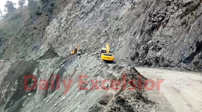 Restoration work on the National Highway at Monkey Morh in Ramban on Tuesday. -Excelsior/Parvaiz Mir