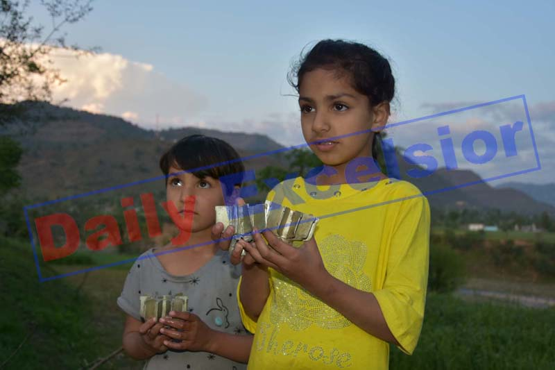 Children show mortar shells fired by Pakistan army in Balakote sector of Mendhar on Monday. —Excelsior/Rahi Kapoor