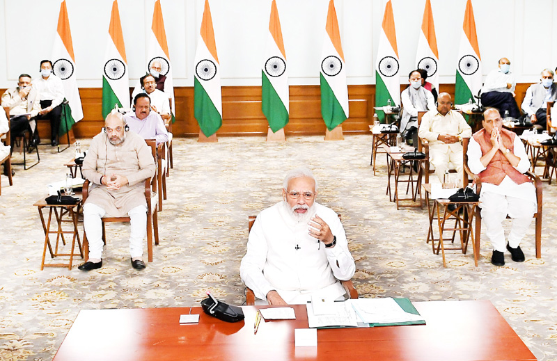 Prime Minister Narendra Modi interacting with the leaders of political parties in Parliament on COVID-19 via video conference in New Delhi on Wednesday.