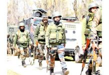 Troops during encounter at DH Pora in Kulgam on Saturday. -Excelsior/Sajad Dar