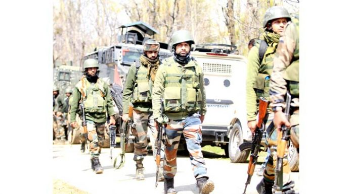 Troops during encounter at DH Pora in Kulgam on Saturday. -Excelsior/Sajad Dar