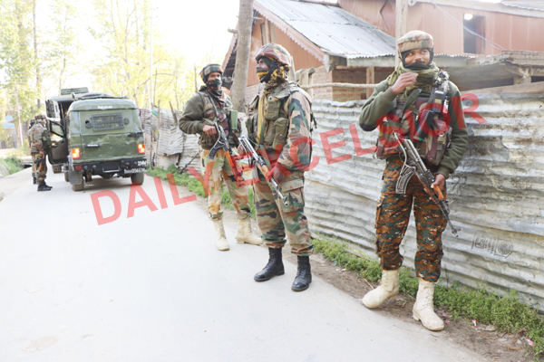 Troops at the encounter site at Melhora, Shopian on Wednesday. —Excelsior/Younis Khaliq