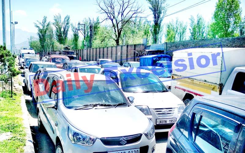 Trafic jam at Bemina Crossing in Srinagar during lockdown on Thursday. -Excelsior/Shakeel