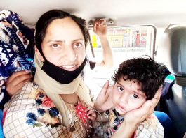 A woman gets emotional with her kin as she leaves for Kashmir from quarantine centre in Kathua on Wednesday. -Excelsior/Pardeep Sharma
