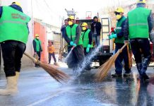 Washing and Disinfection Drive being carried out in Kargil on Saturday.-Excelsior/Basharat Ladakhi